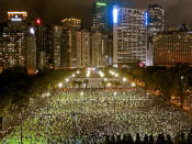 FILE - In this June 4, 2020, file photo, thousands of people attend a candlelight vigil in Hong Kong's Victoria Park to mark the anniversary of the military crackdown on a pro-democracy student movement in Beijing. (AP Photo/Vincent Yu, File)