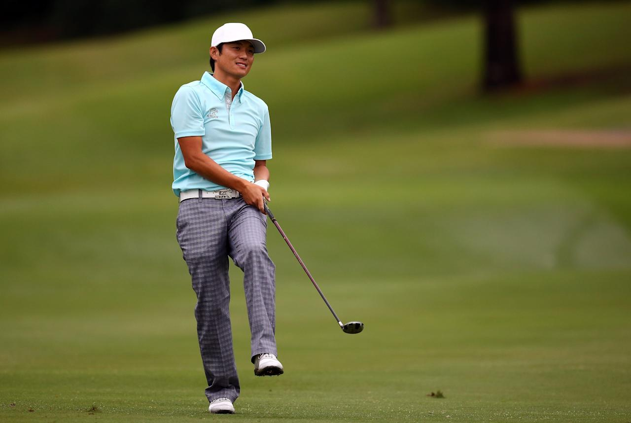 IRVING, TX - MAY 16:  Ryuji Imada of Japan reacts to a shot during the first round of the 2013 HP Byron Nelson Championship at the TPC Four Seasons Resort on May 16, 2013 in Irving, Texas.  (Photo by Tom Pennington/Getty Images)