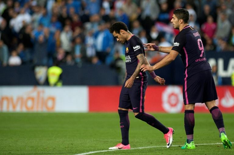 Barcelona's Neymar da Silva (L) was shown a red card during a defeat against Malaga and has since been serving a three-match ban