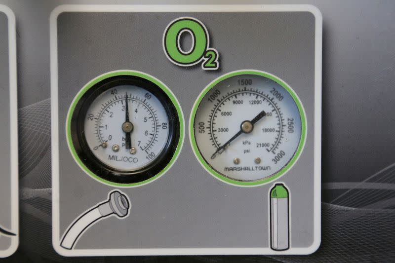 FILE PHOTO: Gauges to regulate oxygen on a ventilator are seen at a lab run by the University Health Network in Toronto