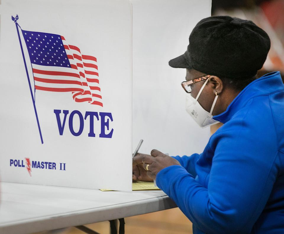 A woman votes at Creekside Elementary in Fairfield, Ohio, on Election Day, Tuesday, Nov. 3, 2020.