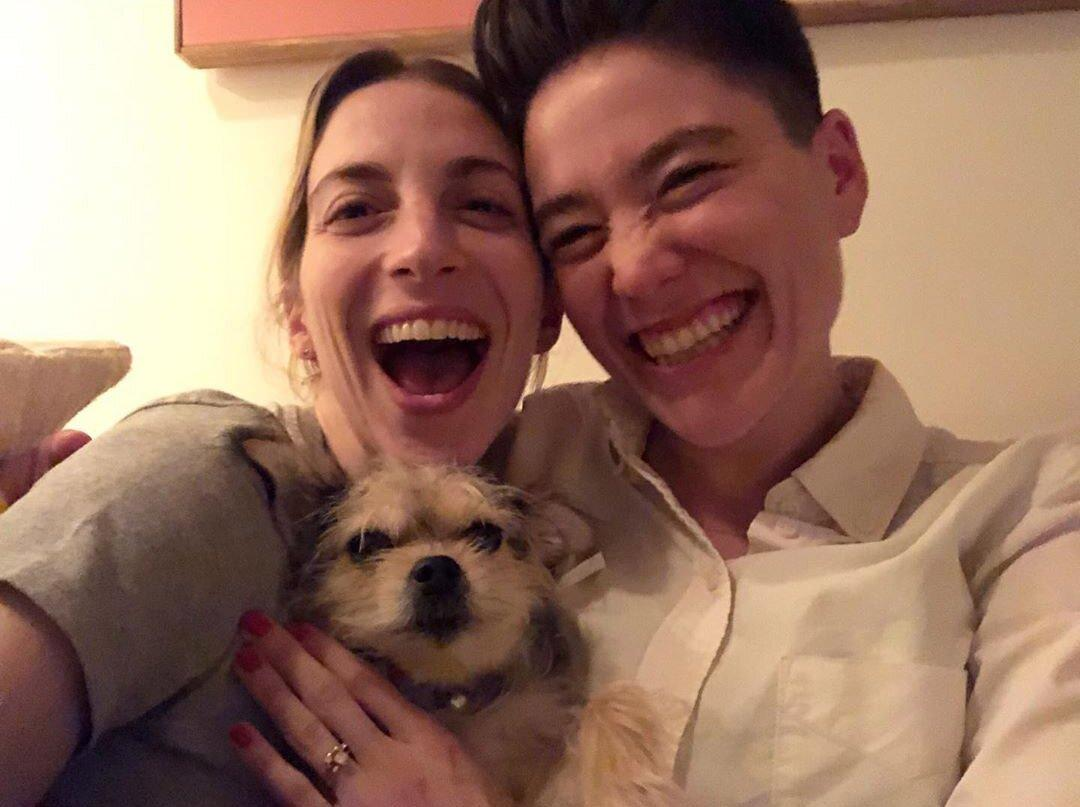 "<em>The Younger</em> star and her girlfriend <a href=""https://people.com/tv/younger-star-molly-bernard-engaged/"">announced their engagement</a> on Jan. 14.  ""We said YES!"" Bernard captioned the smiling selfie on Instagram, which featured the couple as well as their dog, Henry. The shot offered a glimpse at the <em>Chicago Med</em> actress's uniquely shaped sparkler, which appeared to feature a large center diamond topped with a half halo."