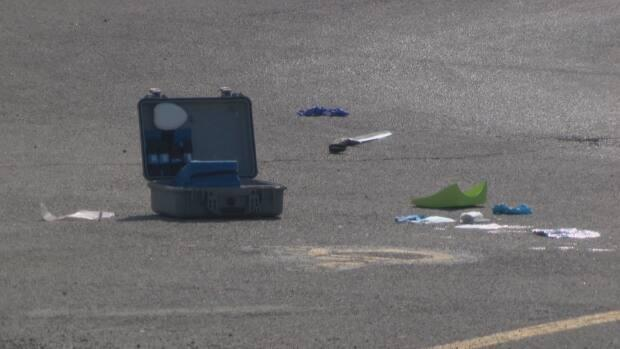 A sword could be seen on the ground near Montreal Road Sunday morning. SIU are investigating after a 28-year-old man was shot by police. (Eloic Hamel/Radio-Canada - image credit)