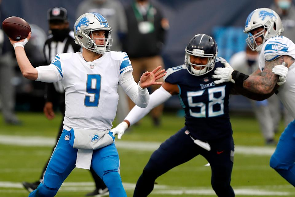 Quarterback Matthew Stafford of the Detroit Lions drops back to pass against the defense of the Tennessee Titans during the second quarter of the game at Nissan Stadium on Dec. 20, 2020 in Nashville, Tennessee.