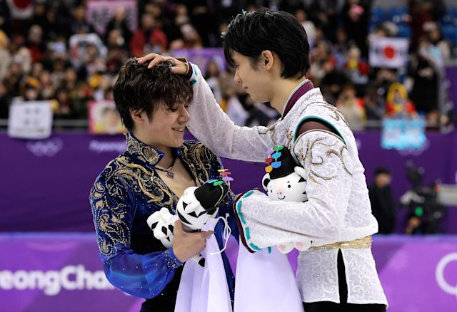 <p>Gold medal winner Yuzuru Hanyu, right, of Japan reacts with teammate and silver medalist Shoma Uno after the men's free figure skating final in the Gangneung Ice Arena at the 2018 Winter Olympics in Gangneung, South Korea, Saturday, Feb. 17, 2018. (AP Photo/David J. Phillip) </p>
