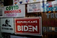 Signs in support of U.S. Democratic presidential candidate Joe Biden hang in the window of the Democratic headquarters in Union City, Pennsylvania