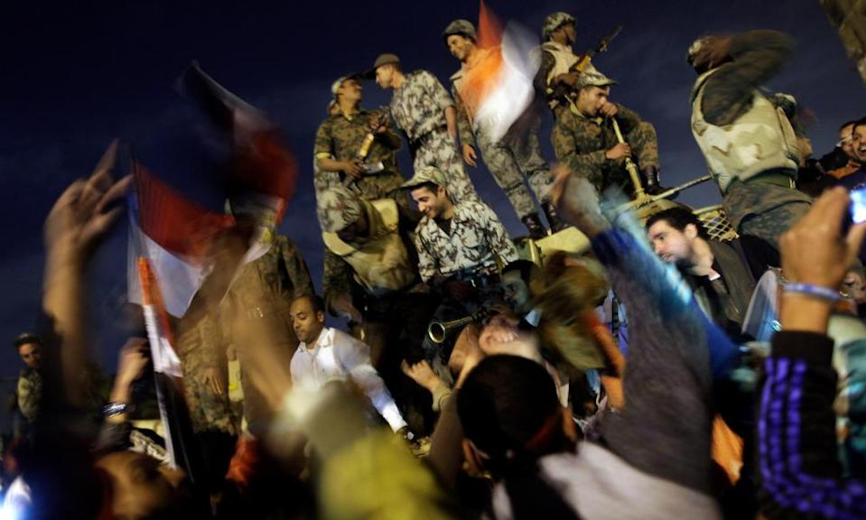 Protesters and soldiers celebrate together in Tahrir Square, Cario, on 11 February 2011 after the announcement of the resignation of Hosni Mubarak.