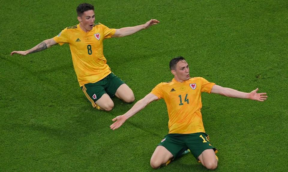 Connor Roberts celebrates with Harry Wilson after scoring Wales' second goal