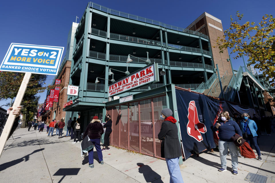 People wait in line to vote at Fenway Park, Saturday, Oct. 17, 2020, in Boston. (AP Photo/Michael Dwyer)