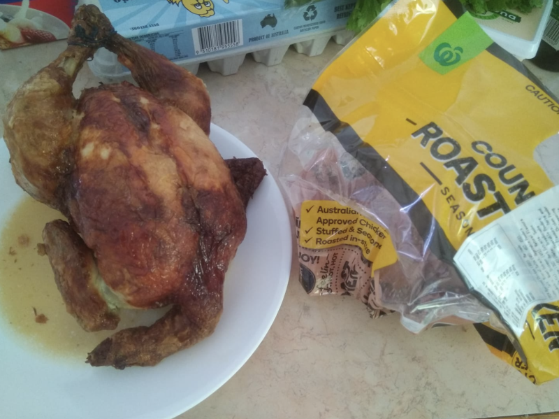 Photo shows Woolworths roast chicken with a neck attached.