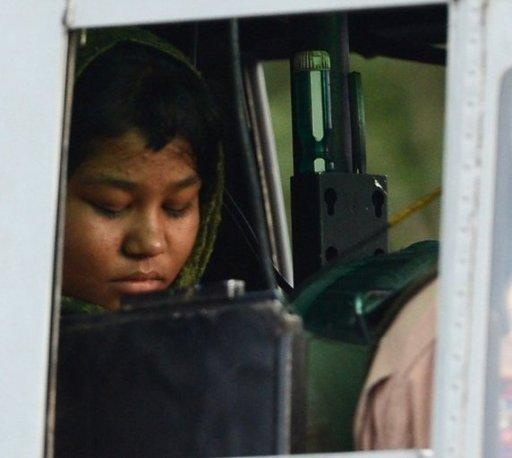 Rimsha Masih, a Christian girl who was accused of blasphemy, sits in helicopter after her release from jail in Rawalpindi on September 8. A Pakistan court has thrown out all charges against Rimsha -- a Christian girl accused of blasphemy for allegedly burning pages of the Koran in a case that drew international condemnation