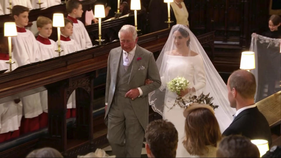 Markle walked down the aisle accompanied part of the way by Prince Charles.