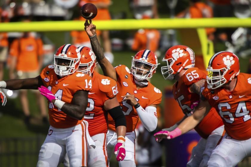 Clemson quarterback D.J. Uiagalelei (5) makes a pass during an NCAA college football game against Syracuse.
