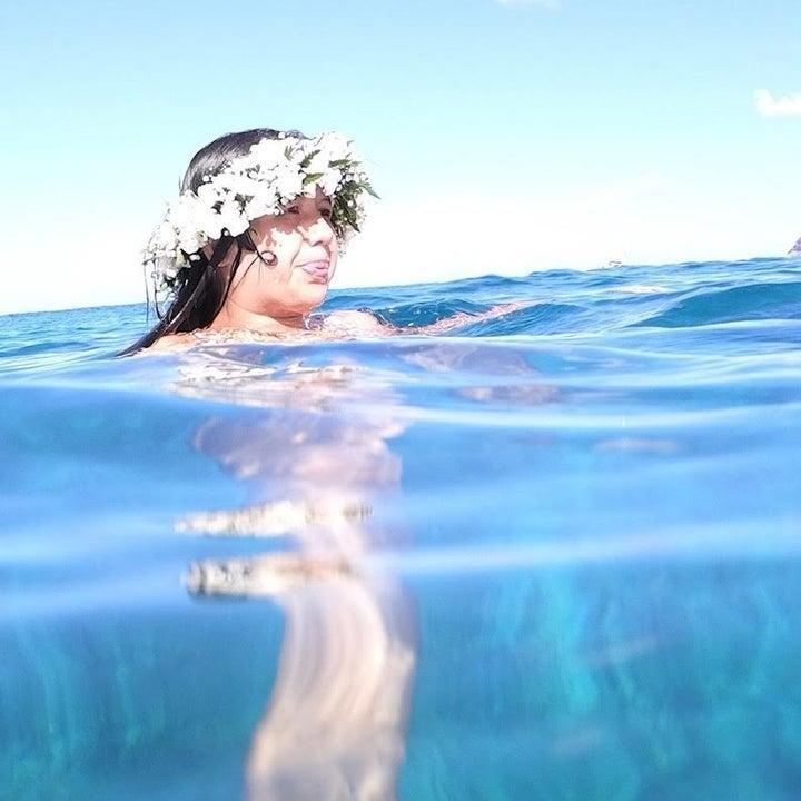 Casey with a flower crown as she floats in the water