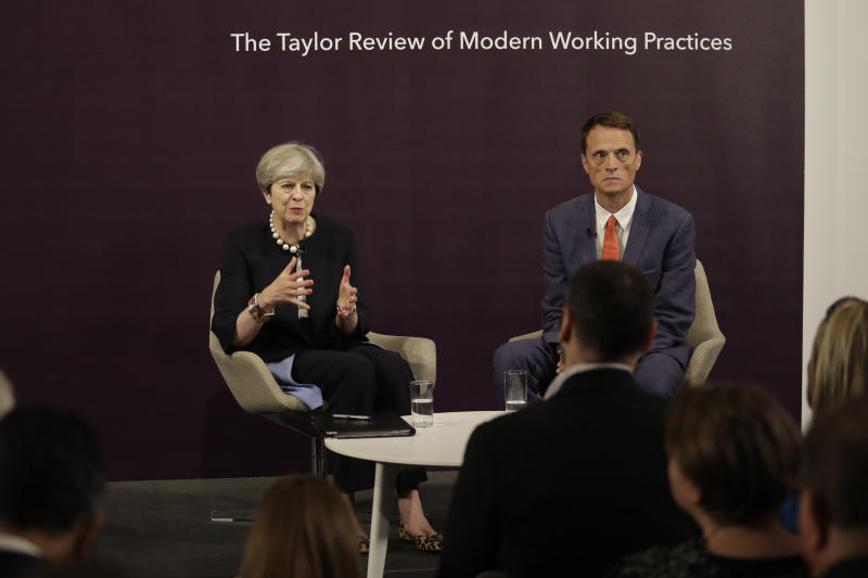 British Prime Minister Theresa May answers a question sat next to RSA Chief Executive Matthew Taylor after delivering a speech at the RSA (Royal Society for the encouragement of Arts, Manufactures and Commerce) in London, Tuesday, July 11, 2017. (AP Photo/Matt Dunham, Pool)