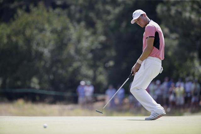 Martin Kaymer, of Germany, reacts after missing a putt on the second hole during the third round of the U.S. Open golf tournament in Pinehurst, N.C., Saturday, June 14, 2014. (AP Photo/David Goldman)