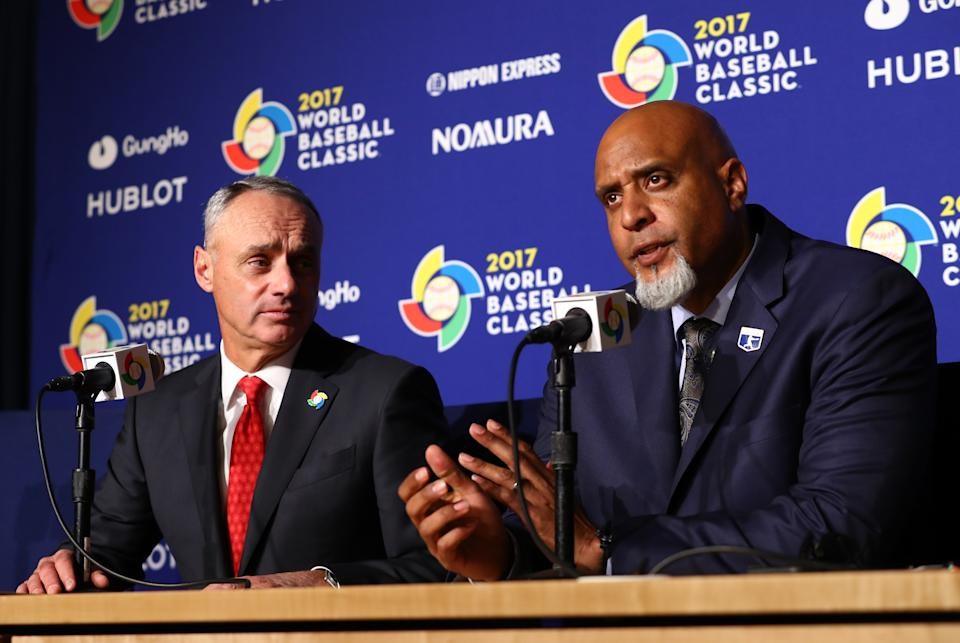 LOS ANGELES, CA - MARCH 22:  Major League Baseball Commissioner Robert D. Manfred Jr. and Major League Baseball Players Association Executive Director Tony Clark speak during a press conference before Game 3 of the Championship Round of the 2017 World Baseball Classic between Team USA and Team Puerto Rico on Wednesday, March 22, 2017 at Dodger Stadium in Los Angeles, California. (Photo by Alex Trautwig/WBCI/MLB via Getty Images)