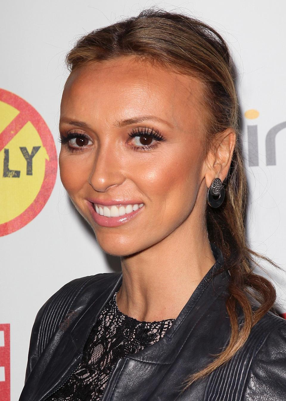"<b>Giuliana Rancic:</b> ""Chills & tears watching coverage of #Aurora shootings. Praying for the innocent lives lost & those in hospital. What a tragedy. "" (Photo by David Livingston/Getty Images)"