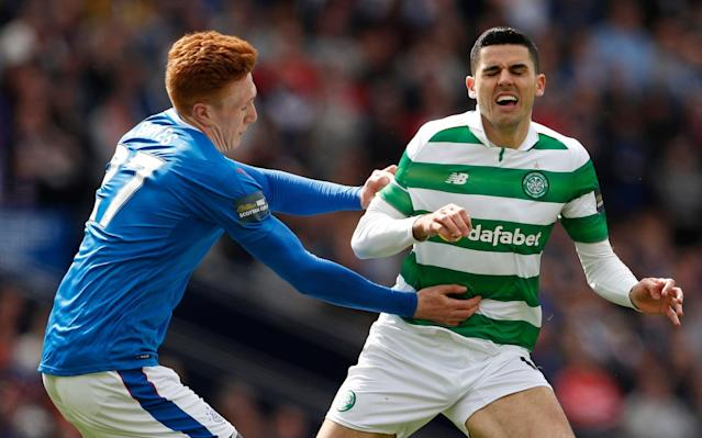 <span>Rangers' Lee Hodson in action with Celtic's Tom Rogic earlier this season</span> <span>Credit:  REUTERS </span>