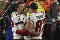 Tampa Bay Buccaneers quarterback Tom Brady (12) and Rob Gronkowski (87) celebrate their win in the NFL Super Bowl 55 football game against the Kansas City Chiefs Sunday, Feb. 7, 2021, in Tampa, Fla. The Buccaneers defeated the Chiefs 31-9 to win the Super Bowl. (AP Photo/Mark LoMoglio)