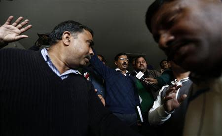 Delhi's Chief Minister Kejriwal, chief of the AAP, leaves after addressing the media during a news conference in New Delhi