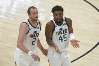 Utah Jazz's Joe Ingles (2) and Donovan Mitchell (45) talk as they walk upcourt in the first half during an NBA basketball game against the Sacramento Kings, Saturday, April 10, 2021, in Salt Lake City. (AP Photo/Rick Bowmer)