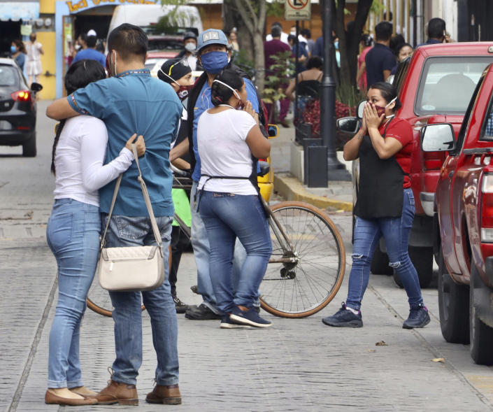 People react after a 7.7 earthquake in Oaxaca, Mexico, Tuesday, June 23, 2020. The earthquake centered near the resort of Huatulco in southern Mexico swayed buildings in Mexico City and sent thousands into the streets. (AP Photo/Luis Alberto Cruz Hernandez)
