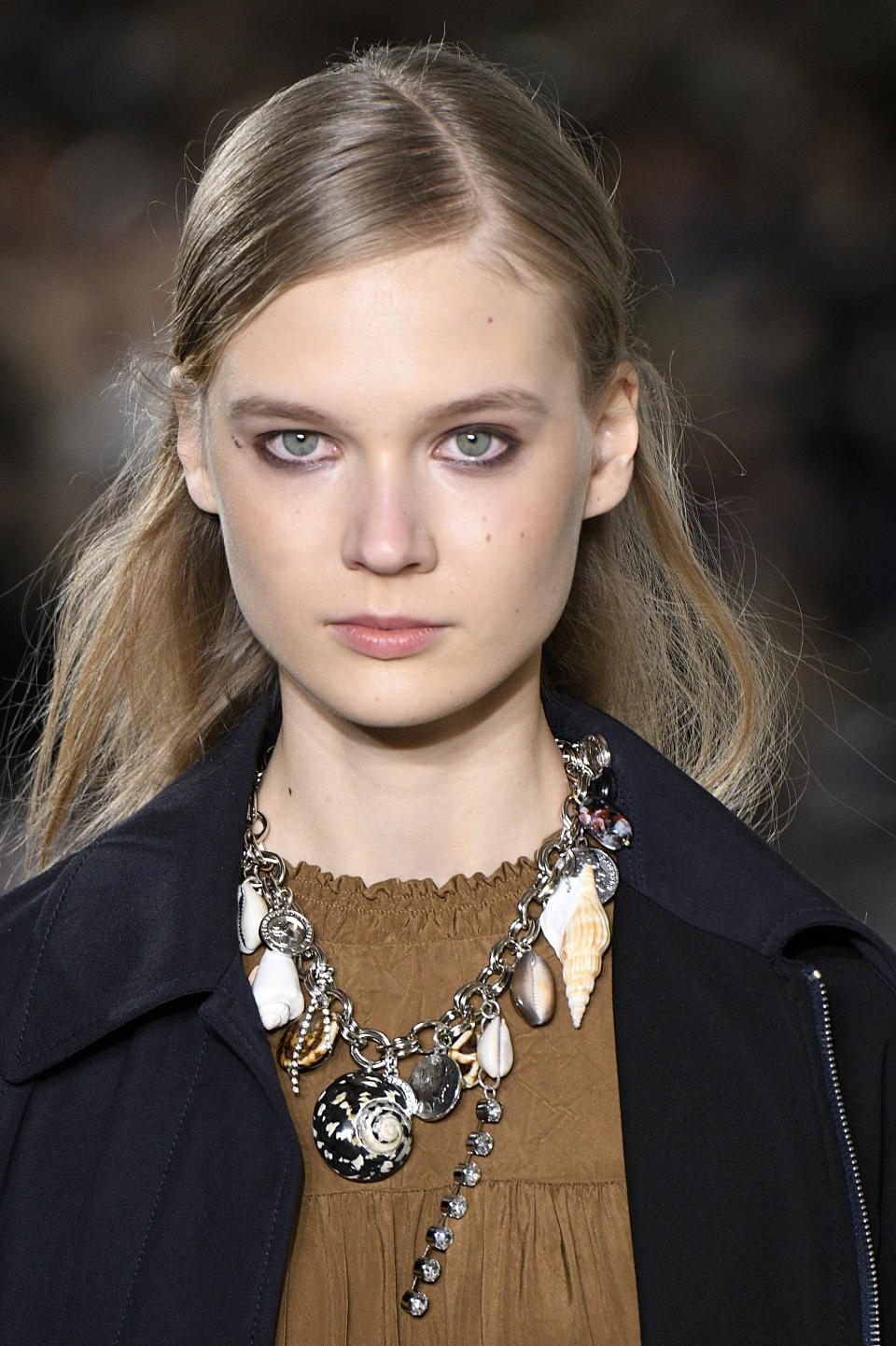 <p>Sea shell and silver coin charm necklace at the 3.1 Phillip Lim FW18 show. (Photo: Getty) </p>