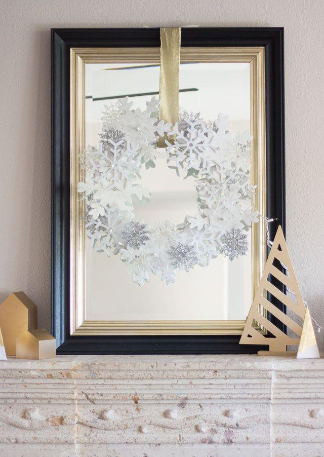 """<p>Dollar store snowflake ornaments affixed to a styrofoam wreath form the basis for this deceptively easy and affordable project. A string of lights woven through makes for the coziest glow.</p><p><a href=""""https://designimprovised.com/2014/12/snowflake-wreath.html"""" rel=""""nofollow noopener"""" target=""""_blank"""" data-ylk=""""slk:Get the tutorial at Design Improvised"""" class=""""link rapid-noclick-resp""""><em>Get the tutorial at Design Improvised</em></a></p>"""