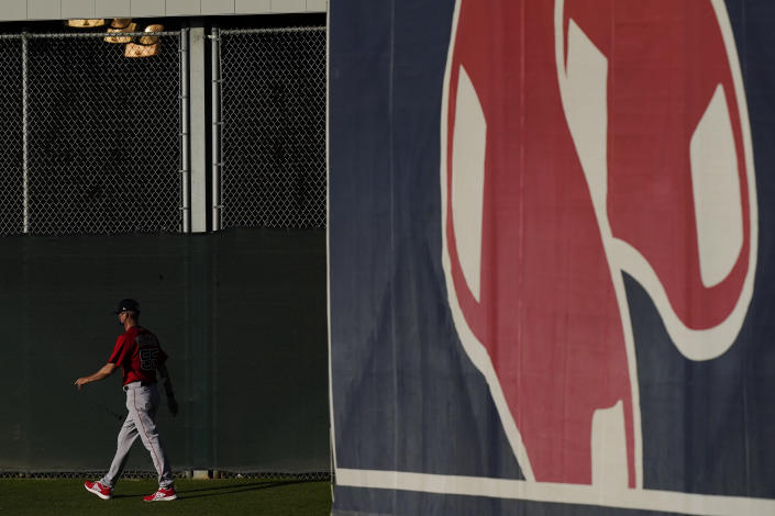 Boston Red Sox bullpen coach Kevin Walker strolls out to the field during spring training baseball practice on Monday, Feb. 22, 2021, in Fort Myers, Fla. (AP Photo/Brynn Anderson)