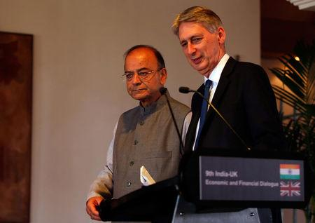 Britain's Chancellor of the Exchequer Philip Hammond (R) and India's Finance Minister Arun Jaitley arrive to address a joint news conference in New Delhi, India April 4, 2017. REUTERS/Altaf Hussain