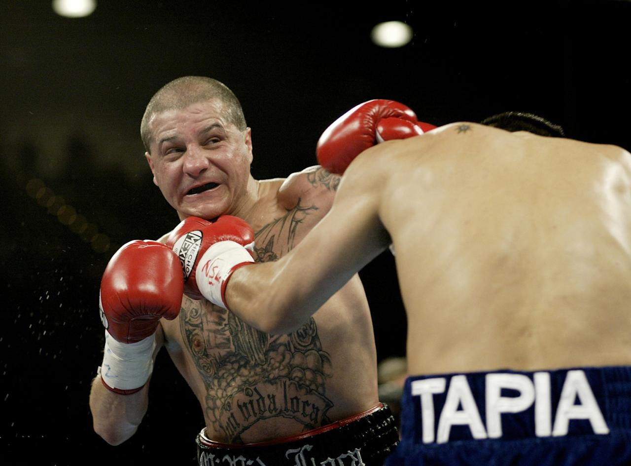 "LAS VEGAS, NV - NOVEMBER 2:  Johnny Tapia defends against Marco Antonio Barrera (R) during their featherweight championship fight at the MGM Grand Garden Arena on November 2, 2002 in Las Vegas, Nevada. Johnny Tapia has been found dead at his home in Albuquerque, New Mexico at the age of 45. Police reports have stated that the death ""did not appear to be suspicious"". (Photo by Jed Jacobsohn/Getty Images)"