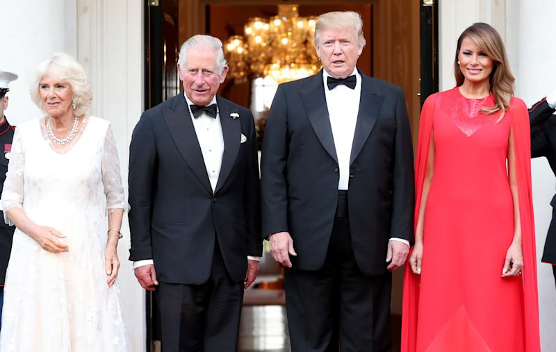 The Prince of Wales and the Duchess of Cornwall are greeted by US President Donald Trump and his wife Melania outside Winfield House, the residence of the Ambassador of the United States of America to the UK, in Regent's Park, London, for the Return Dinner as part of his state visit to the UK.