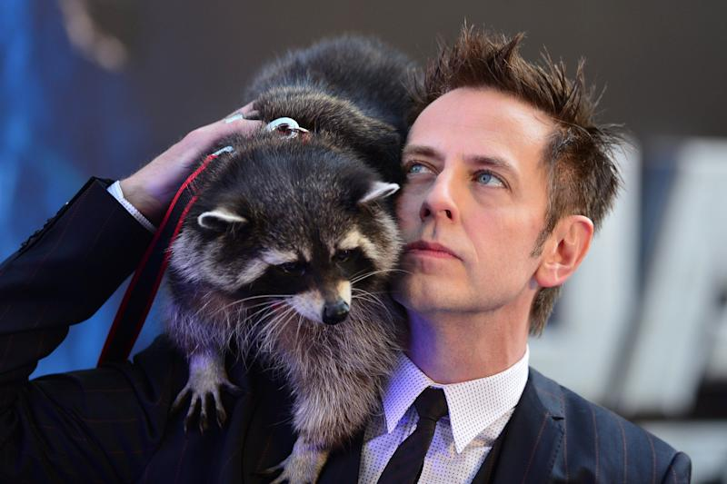 US director James Gunn (R) and a racoon attend the European premiere of the film, Guardians of the Galaxy in central London on July 24, 2014. AFP PHOTO / CARL COURT (Photo credit should read CARL COURT/AFP/Getty Images)