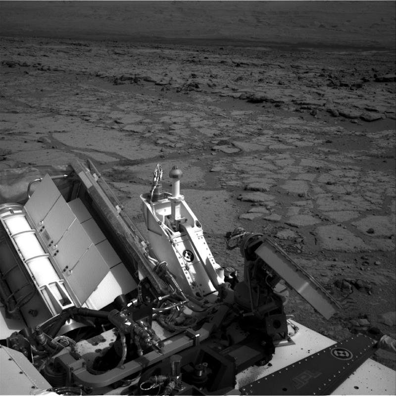 "FILE - This Dec. 12, 2012 file image provided by NASA shows the Mars rover Curiosity at a pit stop, a shallow depression called ""Yellowknife Bay.""  It took the image on the 125th Martian day, or sol, of the mission (Dec. 12, 2012), just after finishing that sol's drive. The Sol 125 drive entered Yellowknife Bay and covered about 86 feet (26.1 meters). The descent into the basin crossed a step about 2 feet (half a meter) high, visible in the upper half of this image. Curiosity will now head for Mount Sharp in mid-February after it drills into its first rock. (AP Photo/NASA/JPL-Caltech, File)"