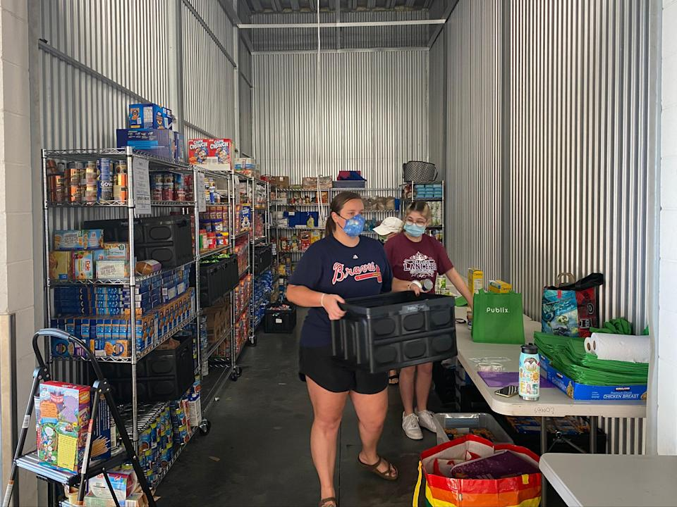 Emily Lartigue started a food bank for Disney employees who have been laid-off or furloughed during the pandemic.  (Richard Hall / The Independent)