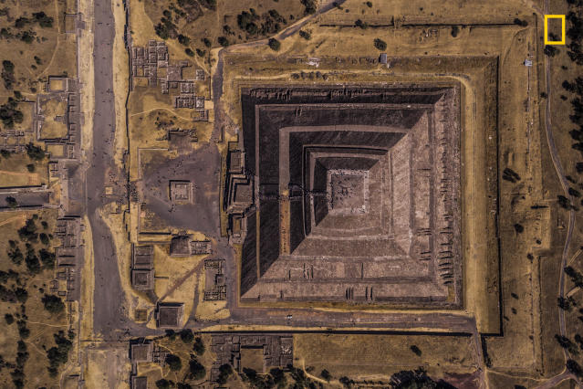 "<p>Photograph and caption by Enrico Pescantini/National Geographic Travel Photographer of the Year Contest. — ""Teotihuacan means 'the place where the gods were created,' and that's the exact feeling visitors have when they walk along the Avenue of the Dead at this Mexican archeological site. This pyramid was dedicated to the god of Sun, and I found it mesmerizing how the rising sun in the picture conquered just half the image, while the other half is in the shadows.<br>I have always loved archeology and ancient civilizations, so I couldn't wait to visit Mexico and explore the remains of the pre-Columbian civilization. I planned my visit to Teotihuacan at sunrise, to get a combination of golden sunlight, play of shadows and few crowds around. I flew my drone to see if the image I had in my mind was really out there: Luckily for me, this frame was just waiting for my camera!"" Teotihuacan, Mexico. </p>"