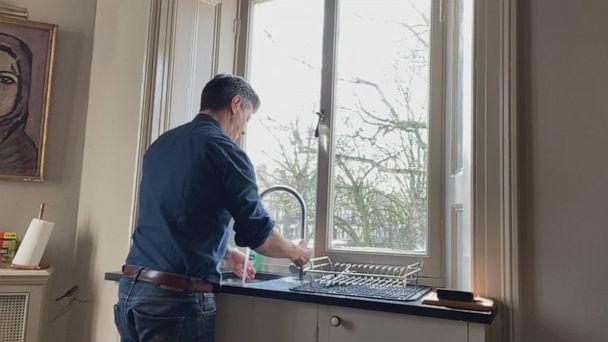 PHOTO: Ian Pannell, senior foreign correspondent for ABC News, washes his hands while looking out of the window of his apartment in the U.K. during a 14-day self-quarantine after reporting in Daegu, South Korea, during the COVID-19 outbreak. (ABC News)