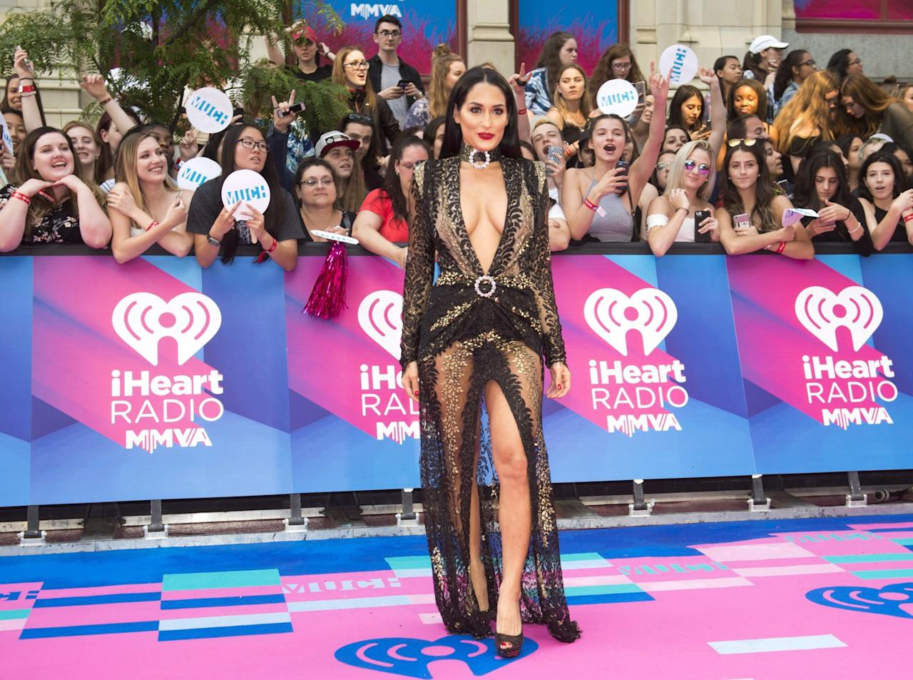 <p>WWE wrestler Nikki Bella looked stunning in a barely-there gown. Work it! </p>
