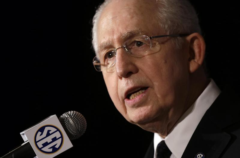 In this July 16, 2013 file photo, Southeastern Conference Commissioner Mike Slive talks with reporters during the SEC football Media Days in Hoover, Ala. Slive addresses an Associated Press Sports Editors meeting with athletes' unionization among the hot topics in college sports, Monday, April 21, 2014, in Birmingham, Ala