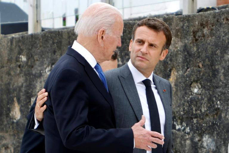 No longer this happy together: France wants 'clarifications' from Biden (AFP/Ludovic MARIN)