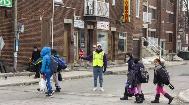 Crossing guard Danny Pavlopoulos is worried about the safety of children when they cross the corner of Bloomfield Ave. and St-Roch Street. (Sandra Hercegova/CBC - image credit)