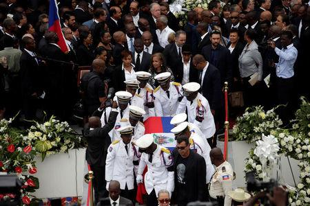Members of the National Palace General Security Unit (USGPN) carry the coffin of Haiti's former President Rene Preval after his funeral in Port-au-Prince, Haiti
