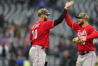 Cincinnati Reds relief pitcher Tejay Antone, left, congratulates center fielder Nick Senzel after the ninth inning of a baseball game against the Colorado Rockies, Sunday, May 16, 2021, in Denver. (AP Photo/David Zalubowski)
