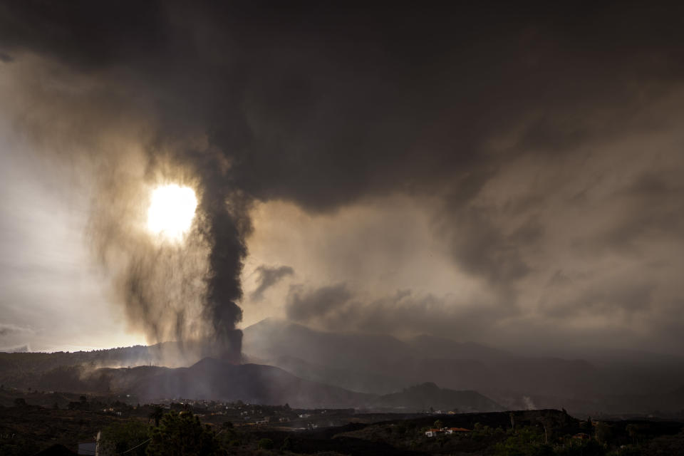Lava from a volcano eruption flows on the island of La Palma in the Canaries, Spain, Wednesday, Sept. 22, 2021. The volcano on a small Spanish island in the Atlantic Ocean erupted on Sunday, forcing the evacuation of thousands of people. Experts say the volcanic eruption and its aftermath on a Spanish island could last for up to 84 days. The Canary Island Volcanology Institute said Wednesday it based its calculation on the length of previous eruptions on the archipelago. (AP Photo/Emilio Morenatti)