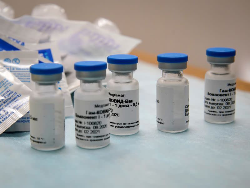 "FILE PHOTO: Bottles with Russia's ""Sputnik-V"" vaccine against the coronavirus disease (COVID-19) are seen before inoculation at a clinic in Tver"