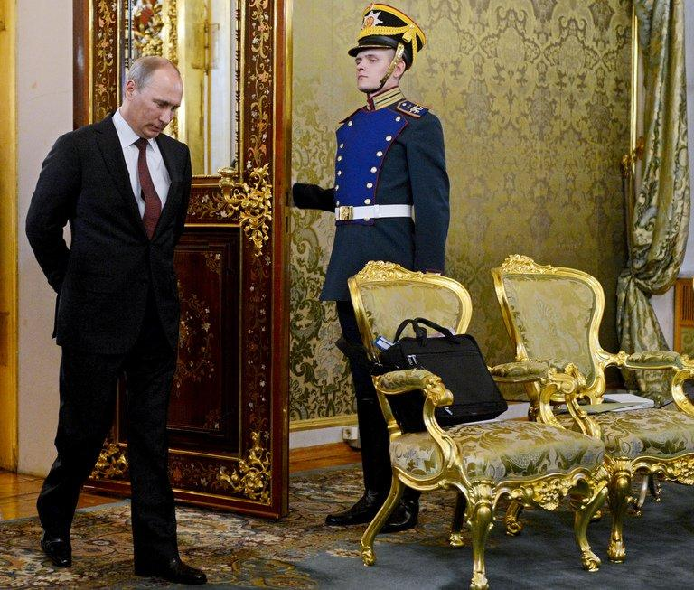 Russian President Vladimir Putin enters a hall for negotiations with Japanese Prime Minister in Moscow on April 29, 2013