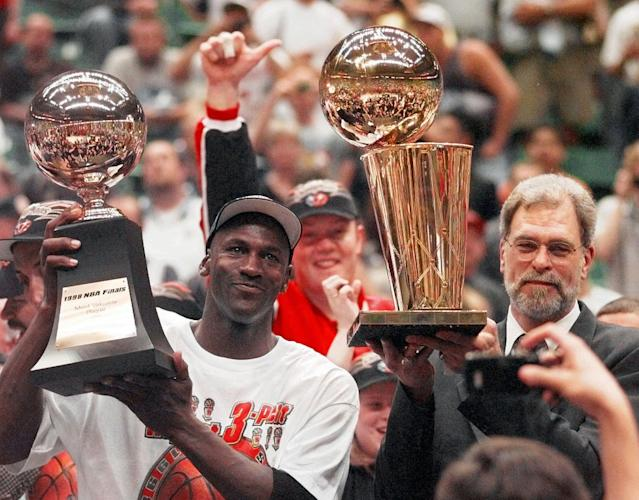 Michael Jordan and Phil Jackson after winning the NBA Finals in 1998.
