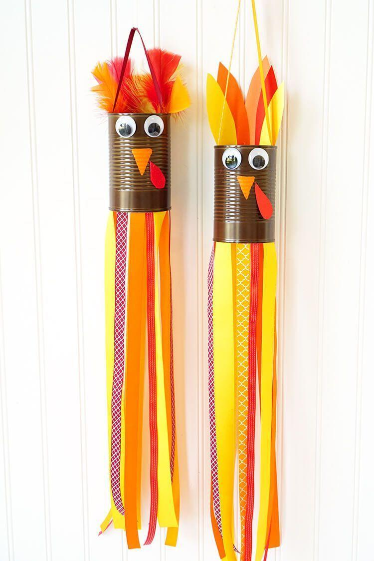 """<p>Attract a flock of turkeys with these noise-free windsocks, customized with the ribbons and feathers of your choice. </p><p><em><a href=""""https://www.happinessishomemade.net/thanksgiving-kids-craft-turkey-windsocks/"""" rel=""""nofollow noopener"""" target=""""_blank"""" data-ylk=""""slk:Get the tutorial at Happiness Is Homemade »"""" class=""""link rapid-noclick-resp"""">Get the tutorial at Happiness Is Homemade »</a></em></p>"""