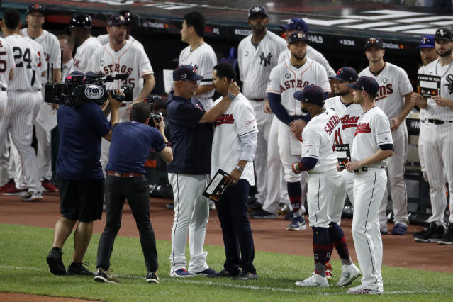 """Cleveland Indians manager Terry Francona, left, hugs Indians pitcher Carlos Carrasco during the middle of the fifth inning of the MLB baseball All-Star Game, Tuesday, July 9, 2019, in Cleveland. The Indians' right-hander, who was recently diagnosed with a form of leukemia, was saluted in the fifth inning of the game as part of Major League Baseball's """"Stand Up to Cancer"""" campaign. (AP Photo/Ron Schwane)"""
